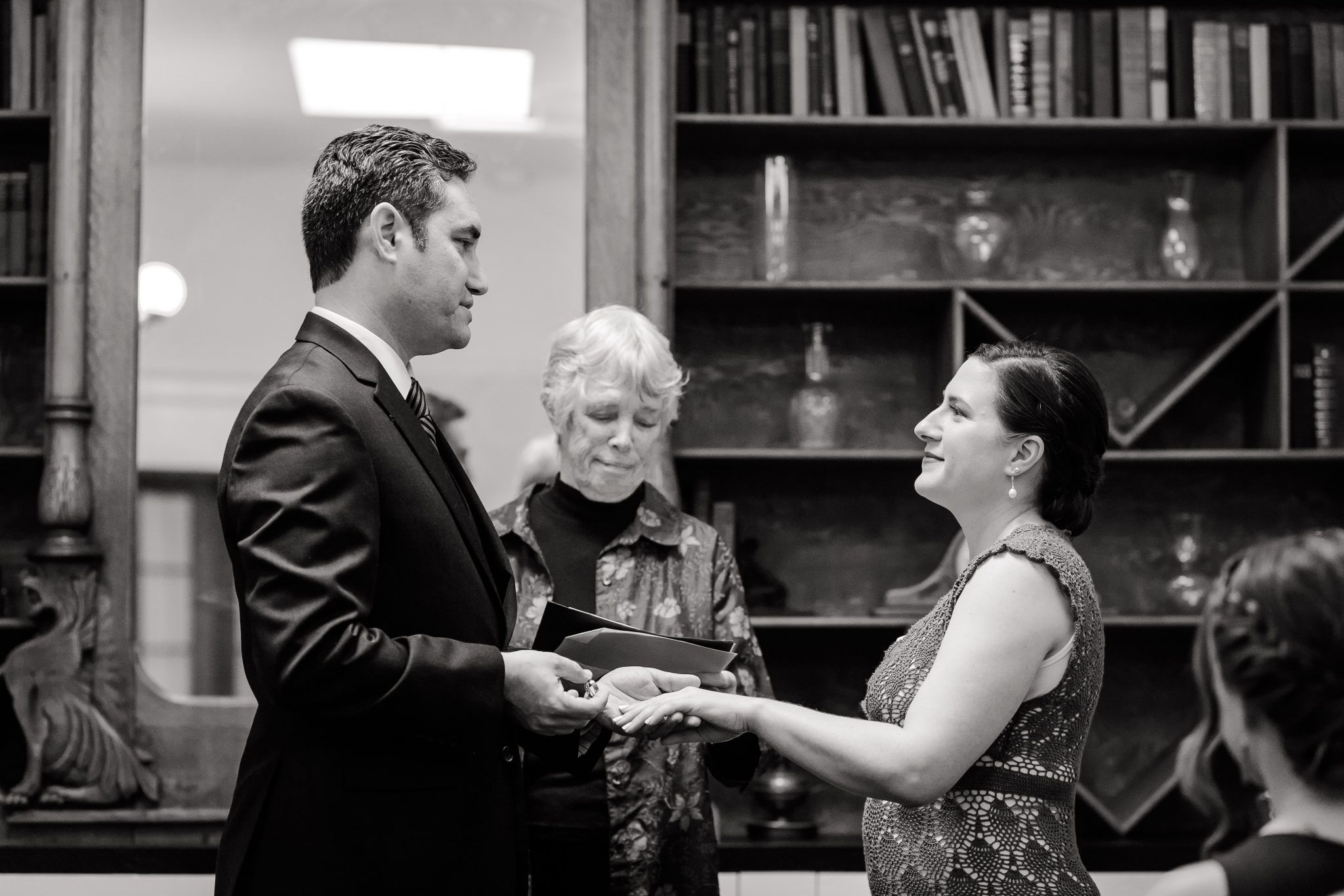 A Black and white image of a bride and groom at the altar.