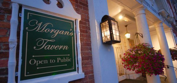 Exterior of the inn shoes the morgan's tavern sign on the brick.